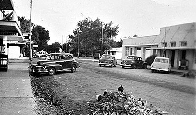 Street widening of Main Street in downtown Bastrop (facing south) in the early 1950's