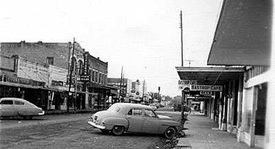 Street widening of Main Street in downtown Bastrop (facing north) in the early 1950's