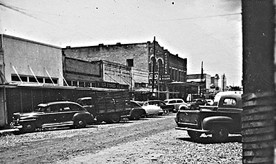 Another view of street widening of Main Street in downtown Bastrop (facing north) in the early 1950's